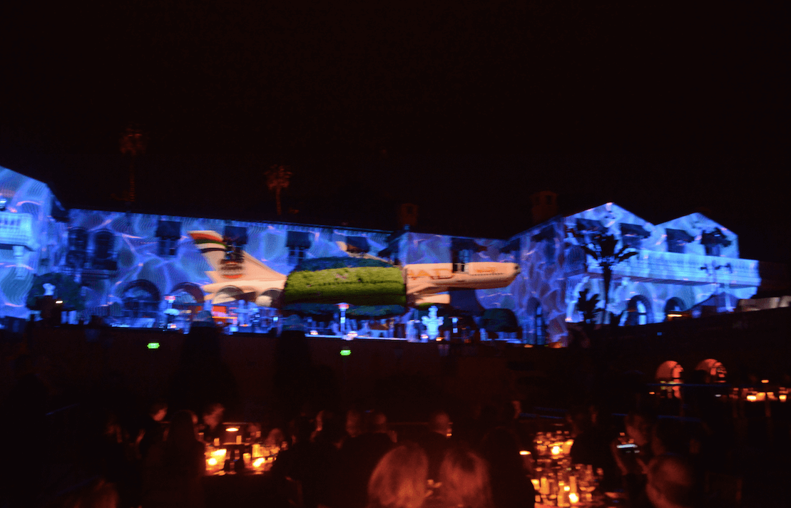 Etihad airplane projected on building at event